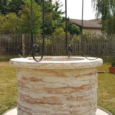 puits en pierre reconstituée
